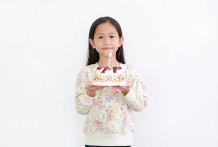Portrait little asian kid girl holding happy birthday cake isolated on white background Archivio Fotografico