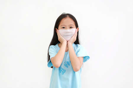 Little asian girl using wet wipes tissue shield her nose and mouth on white background. Protection coronavirus (Covid-19) infection concept Archivio Fotografico