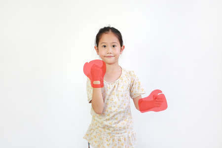 Portrait of Asian little child with concept red boxing gloves isolated on white background