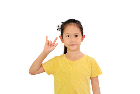 Asian little child show finger I love you symbol sign language on white isolated background