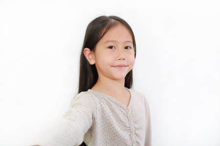 Portrait of smiling asian little child girl on white isolated background