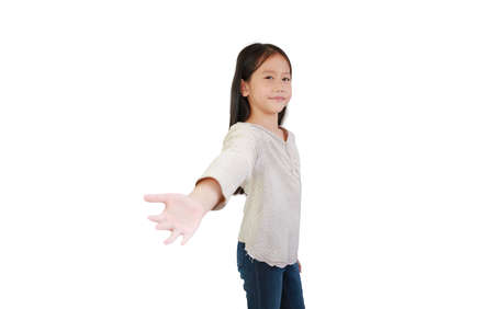 Asian little child girl welcome open hand gesture and smile isolated on white background. Stock Photo