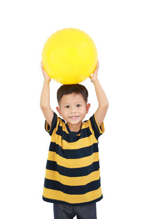 Adorable Asian little baby boy holding round silicone inflatable yellow knobby ball isolated on white background with clipping path