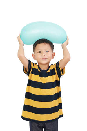 Portrait of Asian little baby boy lift up cyan balloon on head isolated on white background