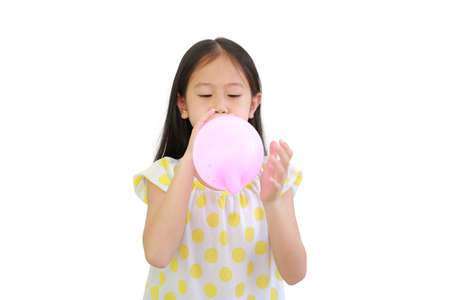 Asian little child girl blowing pink balloon isolated on white background