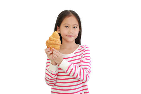 Portrait Asian little child girl holding croissant isolated on white background 免版税图像