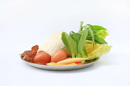 Vegetable sukiyaki set on white background