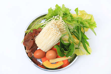 Vegetable sukiyaki set on white background. Top view