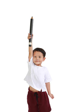 Asian little boy hold and lift up big pencil over head isolated on white background. Kid and education concept