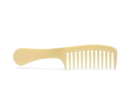 Beige comb isolated on white background