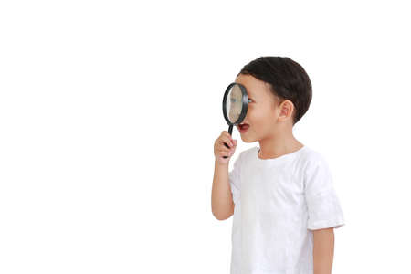 Asian little baby boy looking through a magnifying glass to beside isolated on white background with copy space