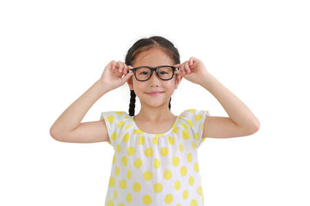 Portrait of smiling asian little girl child wearing glasses isolated on white background