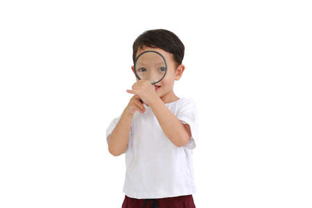 Asian little baby boy looking through a magnifying glass isolated on white background 免版税图像