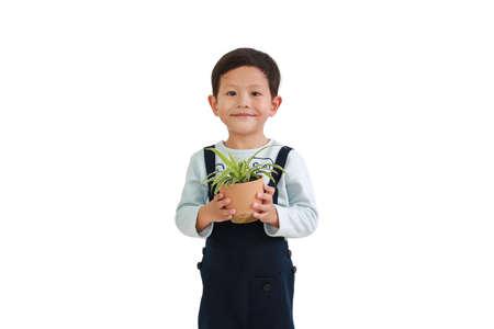 Asian little boy holding tree pot isolated on white background.