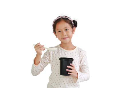 Asian young girl child hold and eating food from black cup isolated on white background. Food and advertising concept. Standard-Bild