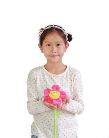 Portrait of young Asian girl child holding artificial flower giving for you isolated over white background. Standard-Bild