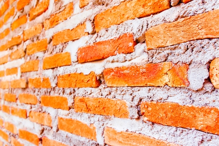 vignetted: Red brick wall, tilt. selective focus