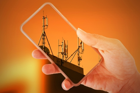 Double exposure. Hand holding smartphone Overlapping image telephone tower.
