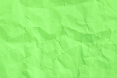 wrinkled sheet of green paper