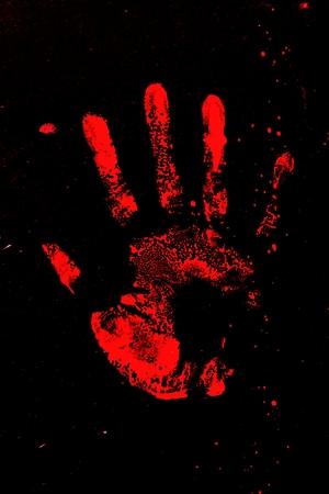 Set of red hand prints on black background Banco de Imagens