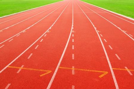 red running track on athletic stadium