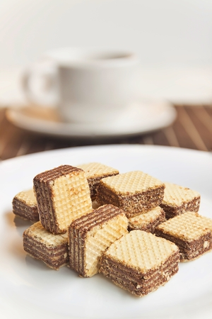 Wafers cubes with chocolate. on White plate Banco de Imagens