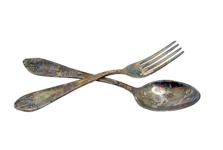 Spoon and fork on a white background. Stock Photo