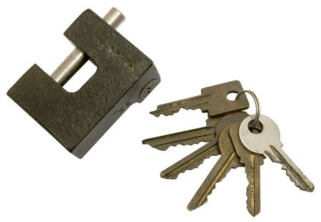 The lock and sheaf of old keys on a white background.