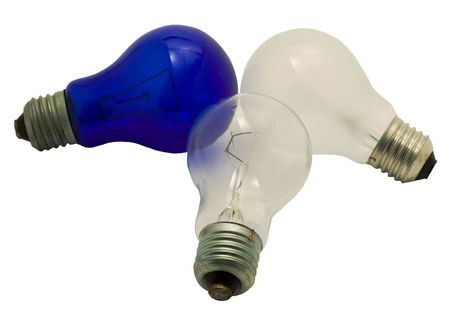 Three electric lamps on a white background. Photo.