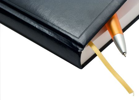The note book with a pen on a white background. Photo.