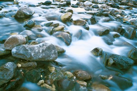 The fast mountain river with clean water. Photo. Stock Photo