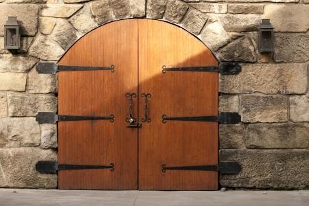 Double doors guard a stone wall   photo