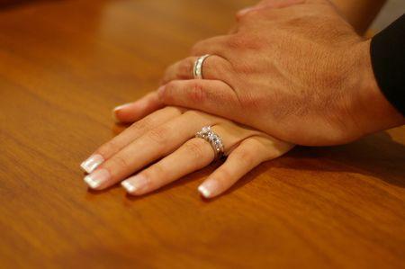 Bride and groom hands Imagens