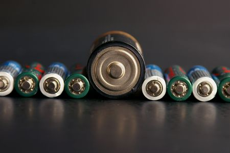 singular: Assorted batteries with one large one Stock Photo