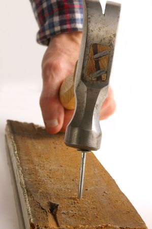 Hammer pounding nail photo
