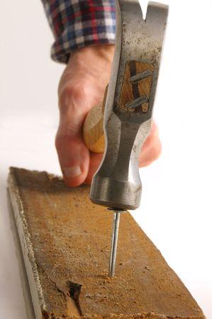 pounding: Hammer pounding nail