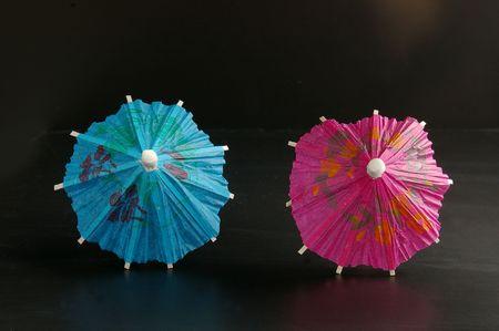 One red, one blue umbrella photo