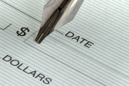 pay wall: Writing a check Stock Photo