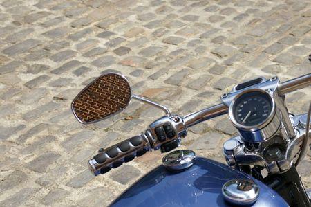Motorcycle on cobblestone Stock Photo
