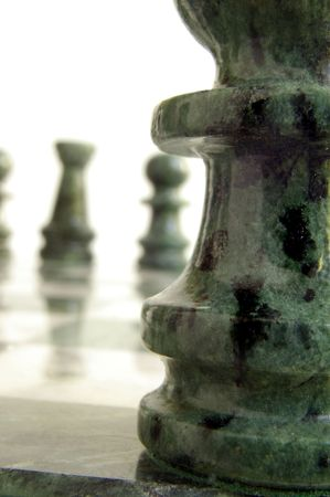 Chess pieces closeup and far