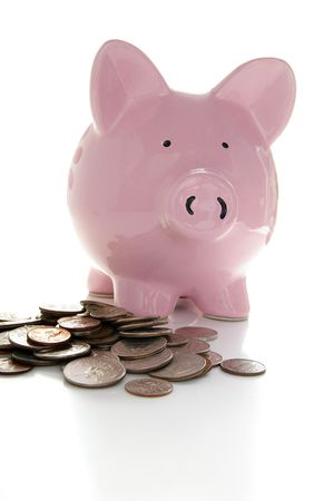 ira: Piggy bank and coins Stock Photo