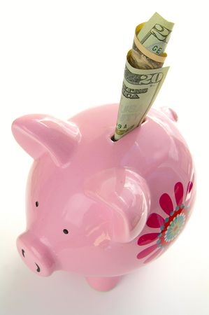 nestegg: Piggy bank with twenty doller bill Stock Photo
