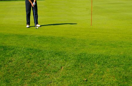 Golf course green and golfer Stock Photo - 652041