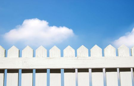 White picket fence and sky Imagens