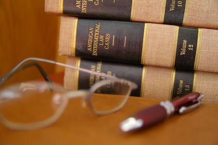 Law books stacked with glasses Stock Photo