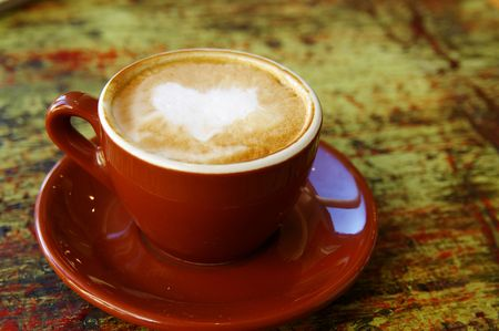 Cappuccino coffee with heart shape photo