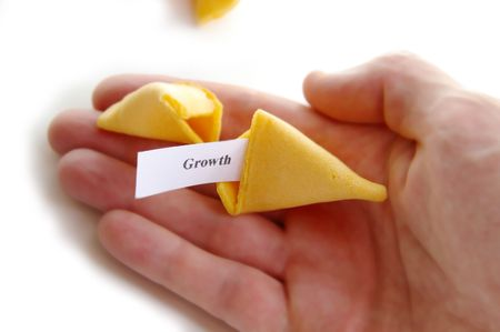 fortune cookie: Growth fortune cookie in hand