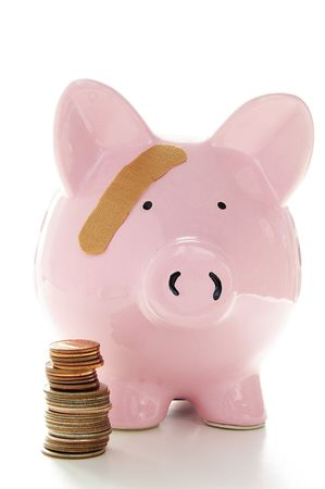 healthcare costs: Piggy bank with band-aid. Symbolizes health-care costs