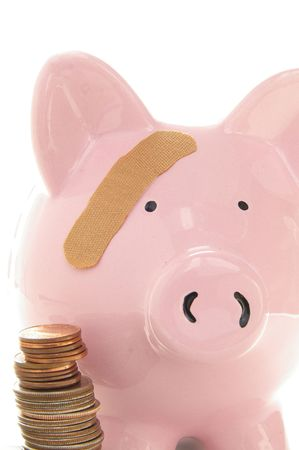 healthcare costs: Piggy bank and coins  with band-aid. Symbolizes health-care costs Stock Photo