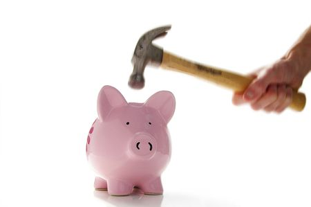 Hammer about to smash a piggiy bank(hand and hammer show motion, piggy bank is sharp) Stock Photo - 651945